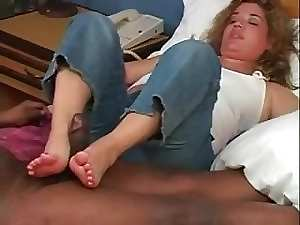 Experienced Interracial footjob