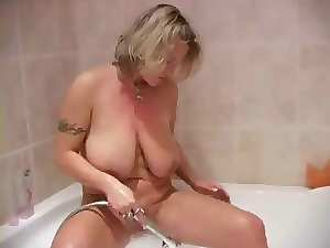 Attractive mom taking shower