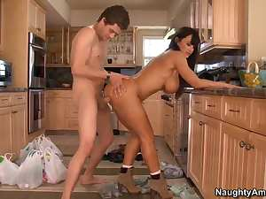 Great brunette with huge fake boobs Lisa Ann is bent over to the counter and being fucked by Xander Corvus.