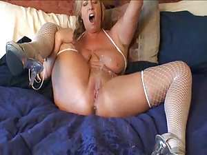 Horny in fishnets uses toys
