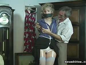 Mature bondage slut with tied tits