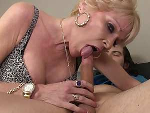 Alluring mature blonde gives a deep blowjob