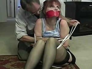 Mature damsel in distress tied up