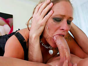 Busty blonde receives facial after getting face fucked