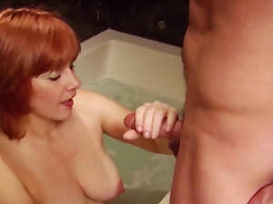 Redhead milf Elizabeth F is sucking in the bath