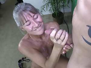 Sweet mature blonde is sucking a cock