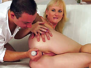 Mature blonde rides on the big hard pole