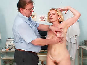 Doctor examines his mature patient