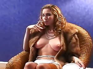 Fur coat beauty smokes sensually