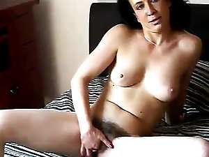 Mature brunette shows her hairy sexy pussy