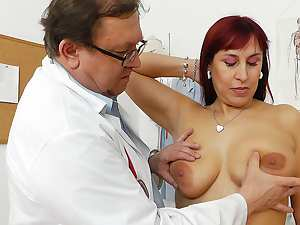 Sexy redhead mature Darja fucks with toys