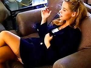 In work outfit she smokes and looks sexy