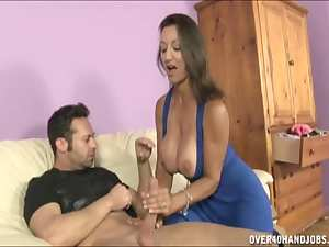 Busty mature brunette demonstrates her big boobies
