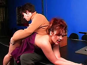 Over the knee spanking with redhead