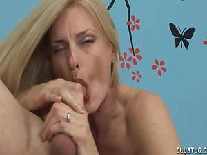 Mature blonde is sucking a horny dick