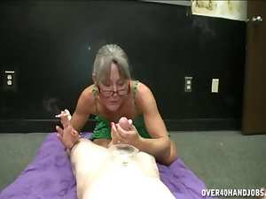 Mature in glasses is smoking and masturbating
