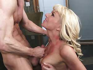 Blonde cougar nailed by a strong dick
