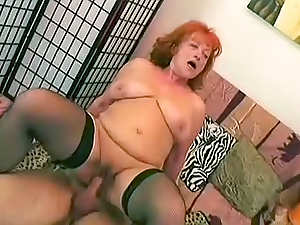 Redhead Eva with huge boobies is sucking well