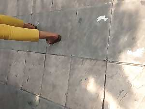 walking attractive mature butt yellow pant