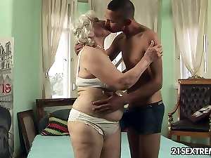 Granny Norma receives 19 years old boy's strong dick