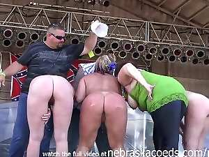 milfy cuties with big ole hooters stripping down in an iowa biker rally