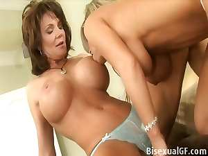 Two mature whores having sex on the bed