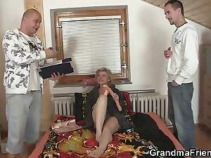 Two delivery men share aged young woman