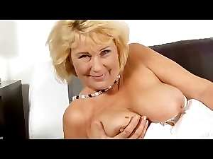 Attractive mature grandma uses rubber toy