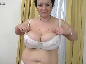 Beauteous attractive mature Momma with big melons